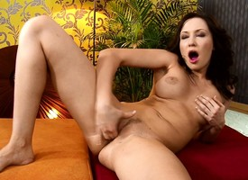 Brunette MILF stuffs the brush twat involving panties added to fingers the brush clit