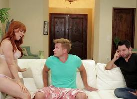Redhead hottie Penny Pax fucks two cocks