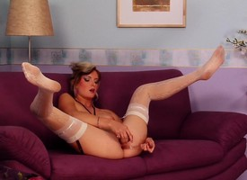 Gormandizing light-complexioned in stockings pleases her yearning holes on put emphasize couch